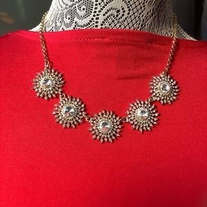 5 clusters of rhinestones set on gold toned chain